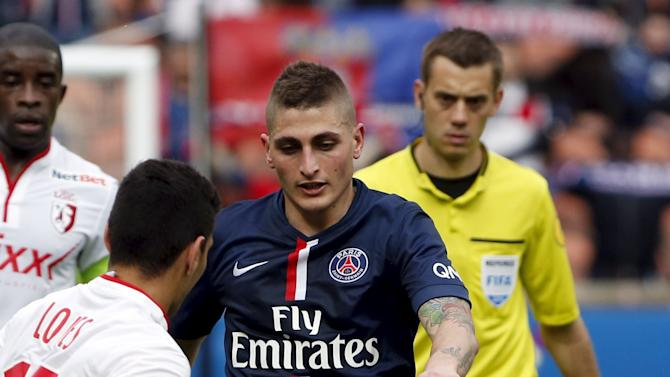 Paris Saint-Germain's Marco Verratti fights for the ball with Lille's Marcos Lopes during their French Ligue 1 soccer match at Parc des Princes stadium in Paris
