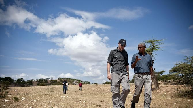 In this 2009 image provided by Charity: Water, Scott Harrison walks in a field in the northern region of Tigray in Ethiopia in 2009, as he visits a water project completed by local partner, Relief Society of Tigray. Harrison's organization has funded nearly 7,000 clean water projects in some of the poorest areas of the world. He wanted to add sensors to the wells to give donors more assurances about the projects. But raising millions of dollars for the innovation was a problem. Google stepped in with major funding to create and install sensors on 4,000 wells across Africa that will send back real-time data on the water flow. Experts say the new annual grants are a part of a growing trend in venture philanthropy from donors who see technology as an instrument for social change. (AP Photo/Charity: Water)