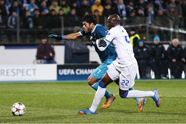 Zenit's Hulk, left, challenges with Porto's Eliaquim Mangala for the ball during the Champions League group G soccer match between Zenit and Porto at Petrovsky stadium in St.Petersburg, Russia, on Wed
