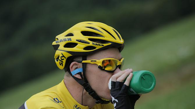 Christopher Froome of Britain, wearing the overall leader's yellow jersey, drinks during the nineteenth stage of the Tour de France cycling race over 204.5 kilometers (127.8 miles) with start in in Bourg-d'Oisans and finish in Le Grand-Bornand, France, Friday July 19 2013. (AP Photo/Christophe Ena)