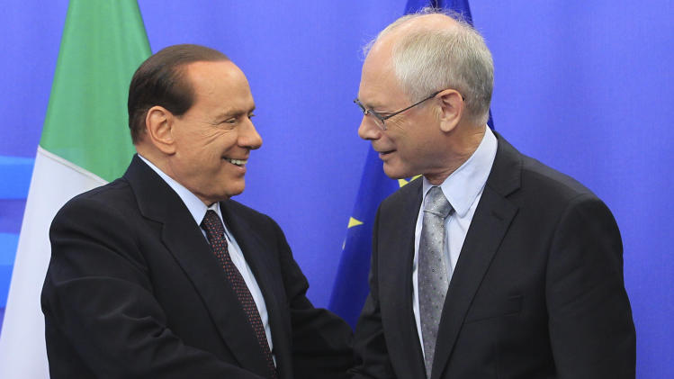 European Council President Herman Van Rompuy, right, welcomes Italy's Prime Minister Silvio Berlusconi prior to a meeting, at the European Council building in Brussels, Tuesday, Sept. 13, 2011. (AP Photo/Yves Logghe)