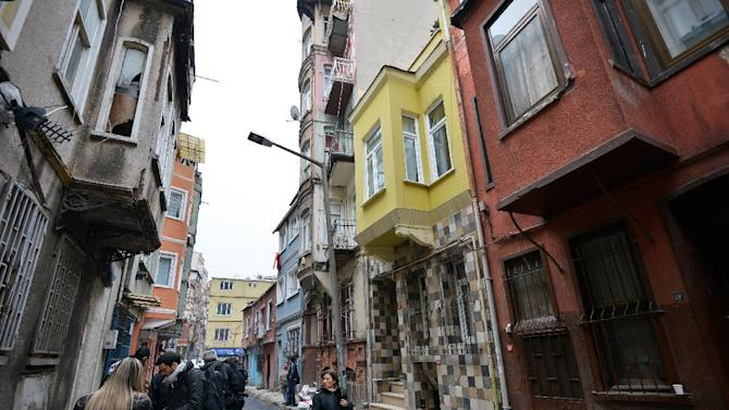 FILE - This Jan. 28, 2013 file photo shows a view of the street with the hostel, in yellow, where Sarai Sierra, a New York City woman was staying in Istanbul, Turkey. Sierra, a 33-year-old mother of two, went missing while vacationing alone in Istanbul. Her body was discovered Feb. 2 amid the ancient city walls in low-income district of Sarayburnu in Istanbul. Recent high-profile attacks on tourists in India, Brazil, Turkey and Mexico have raised questions about personal safety for overseas travel, especially for women. But frequent travelers and those who work in the industry say a few common-sense precautions can go a long way to ensuring personal safety.  (AP Photo, file)