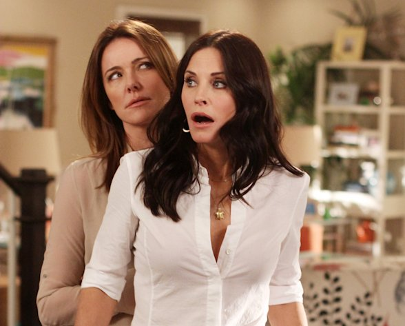 In this publicity image released by ABC, Christa Miller, left and Courteney Cox are shown in a scene from the ABC comedy &quot;Cougar Town.&quot; The ABC sitcom, a cult favorite but never a ratings blockbuster on broadcast television, will be moving to cable&#39;s TBS, the network said Thursday, May 10, 2012. TBS has ordered a fourth season of the sitcom, which was facing cancellation by ABC. New episodes are scheduled to begin airing early next year. (AP Photo/ABC, Michal Ansell)