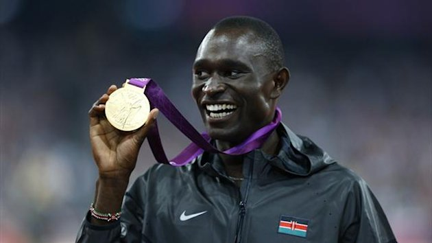 David Rudisha of Kenya shows off his gold medal (Reuters)