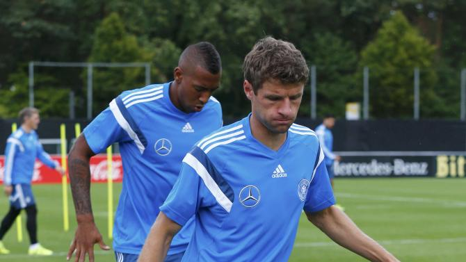 Germany national soccer players Mueller and Boateng take part in training session in Frankfurt
