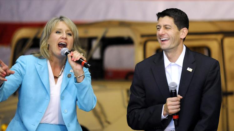 Rep. Renee Ellmers, R-N.C., and Republican vice presidential candidate, Rep. Paul Ryan, R-Wis., answers questions during campaign event at Partnership for Defense Innovation in Fayetteville, N.C., Thursday, Aug. 23, 2012. (AP Photo/Sara D. Davis)
