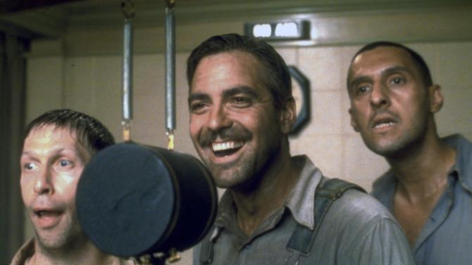 "In this image released by Disney, from left, Tim Blake Nelson, George Clooney and John Turturro are shown in a scene from ""O Brother, Where Art Thou?""  An expanded version of the soundtrack for ""O Brother, Where Art Thou?"" will be released Tuesday and packs 13 previously unreleased tracks along with four other cuts.  (AP Photo/Disney)"