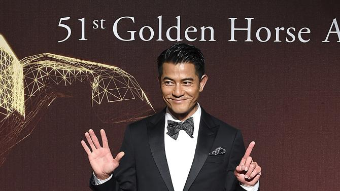 Hong Kong actor and singer Aaron Kwok poses for photographers on the red carpet at the 51st Golden Horse Film Awards in Taipei