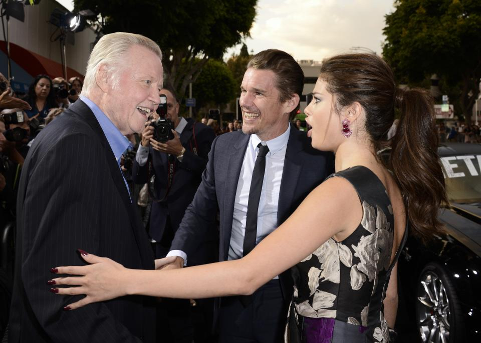 "From left to right, actor Jon Voight, actor Ethan Hawke, and actress Selena Gomez arrive on the red carpet at the premiere of the feature film ""Getaway"" at the Regency Village Theater on Monday, Aug. 26, 2013 in Los Angeles. (Photo by Dan Steinberg/Invision/AP)"