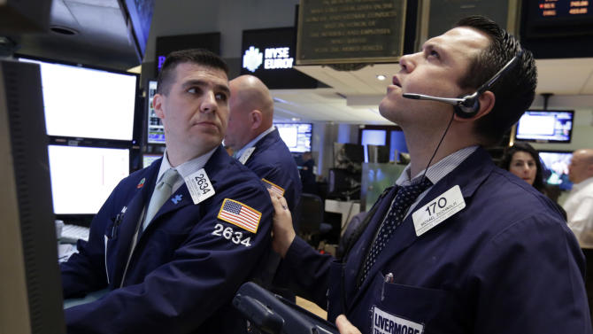 Specialist Matthew Diez, left, and trader Michael Zicchinolfi work on the floor of the New York Stock Exchange Tuesday, April 30, 2013. Stock prices are opening mostly lower on Wall Street as weak earnings from Pfizer and other companies drag down major market averages. (AP Photo/Richard Drew)