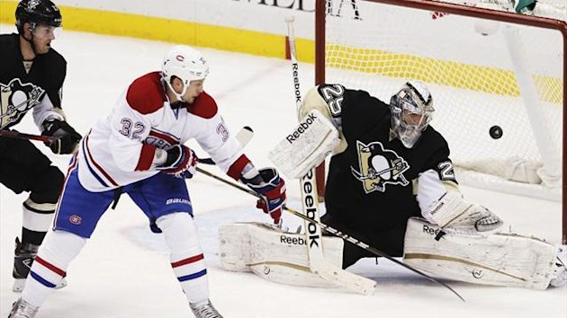 Pittsburgh Penguins goalie Marc-Andre Fleury (29) blocks a shot by Montreal Canadiens' Travis Moen (32) (Reuters)