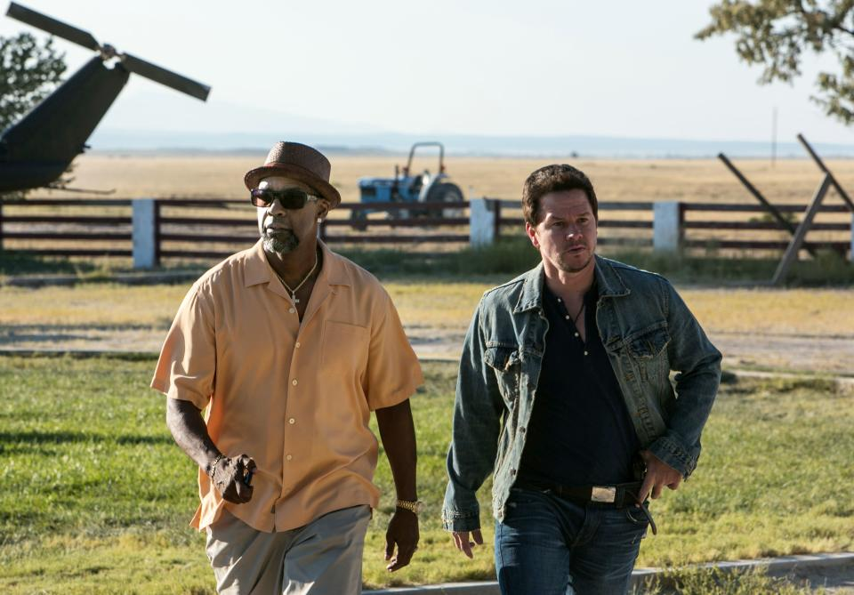 "This image released by Universal Pictures shows Denzel Washington, left, and Mark Wahlberg in a scene from ""2 Guns."" (AP Photo/Universal Pictures, Patti Perret)"