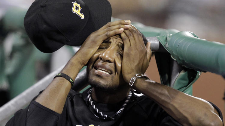 With game-time temperatures in the 90s Pittsburgh Pirates' James McDonald wipes his face in the dugout during the eighth inning of a baseball game against the San Francisco Giants in Pittsburgh, Friday, July 6, 2012. The Giants won 6-5. (AP Photo/Gene J. Puskar)