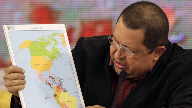 Venezuela's President Hugo Chavez holds a map of the Americas during a session of the Bolivarian Alternative for the Americas, ALBA, trade block at Miraflores presidential palace in Caracas, Venezuela, Sunday, Feb. 5, 2012. (AP Photo/Ariana Cubillos)