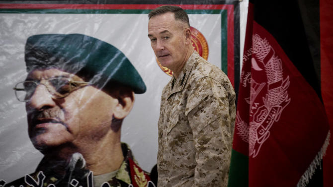 Top U.S commander in Afghanistan General Joseph Dunford leaves the podium after handing over the Parwan Detention Facility to Afghan authorities in Bagram, outside Kabul, Afghanistan, Monday, March 25, 2013. The handover of Parwan Detention Facility ends a bitter chapter in American relations with Afghanistan's mercurial president, Hamid Karzai, who demanded control of the prison as a matter of national sovereignty. (AP Photo/Anja Niedringhaus)