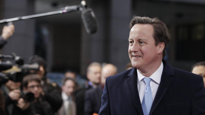 British Prime Minister David Cameron arrives for an EU summit in Brussels on Thursday, Dec. 13, 2012. In one whirlwind morning, the European Union nations agreed on the foundation of a fully-fledged banking union and Greece's euro partners approved billions of euros in bailout loans that will prevent the nation from going bankrupt. (AP Photo/Virginia Mayo)