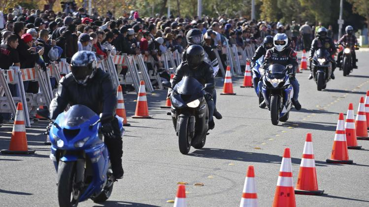 "Motorcycle riders attend an unofficial memorial event for ""Fast & Furious"" star Walker in Santa Clarita"