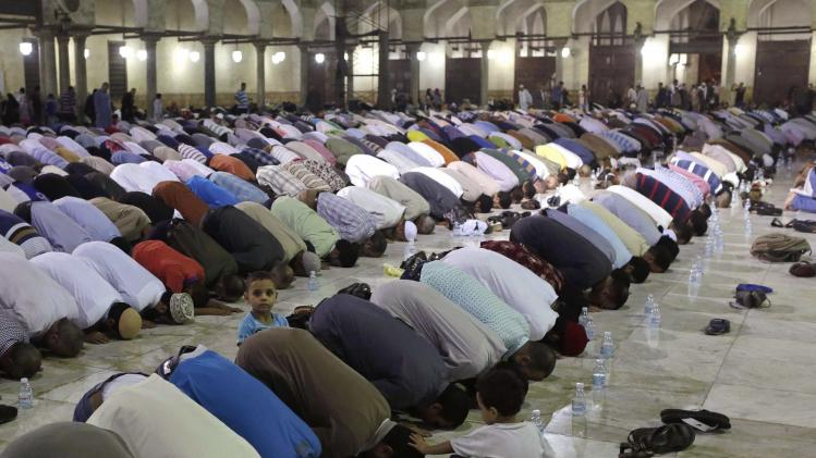 Muslims conduct taraweeh prayers as they gather for Lailat al-Qadr, at a mosque in Cairo