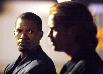 Jamie Foxx as Ricardo Tubbs and Colin Farrell as Sonny Crockett in Universal Pictures' Miami Vice