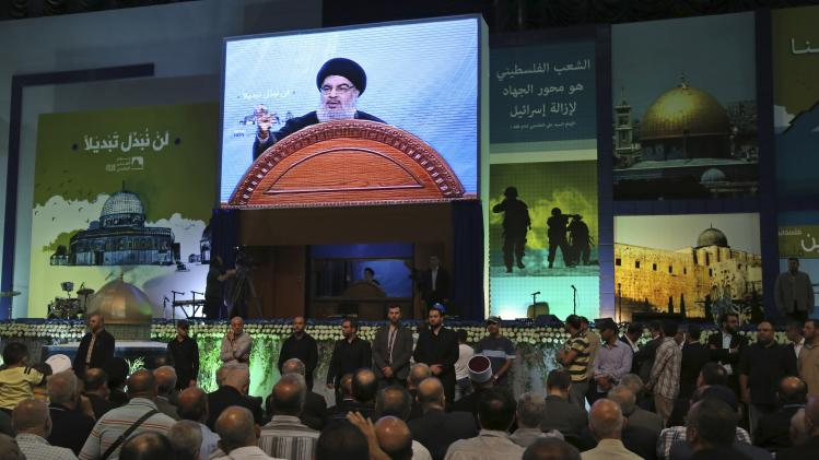 "Lebanon's Hezbollah leader Sayyed Hassan Nasrallah makes a rare public appearance as he addresses his supporters during a rally to mark ""Quds (Jerusalem) Day"" in Beirut's southern suburbs"