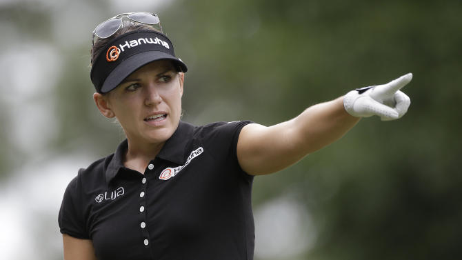 Sydnee Michaels points down the first fairway during the final round of the Mobile Bay LPGA Classic golf tournament at the Robert Trent Jones Golf Trail at Magnolia Grove in Mobile, Ala. Sunday, May 19, 2013. (AP Photo/Dave Martin)