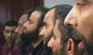 Syria: Rebel Prisoners On Their Religious War