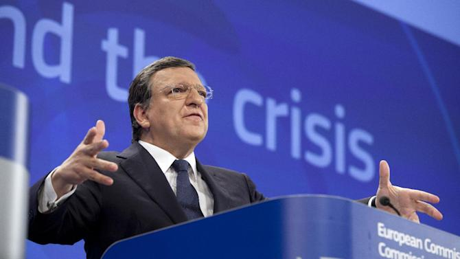 European Commission President Jose Manuel Barroso gestures while speaking during a media conference at EU headquarters in Brussels on Wednesday, May 29, 2013. The European Union announced Wednesday to grant France, Spain and four other member states more time to bring their budget deficits under control to support the bloc's shrinking economy. (AP Photo/Virginia Mayo)