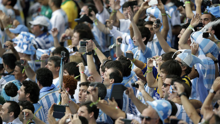 Argentina fans take photos before the start of the group F World Cup soccer match between Nigeria and Argentina at the Estadio Beira-Rio in Porto Alegre, Brazil, Wednesday, June 25, 2014. (AP Photo/Michael Sohn)