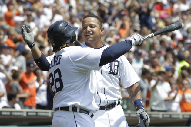 Detroit Tigers&#39; Miguel Cabrera, right, hugs teammate Prince Fielder after hitting a home run during the third inning of a baseball game against the Chicago White Sox in Detroit, Sunday, July 22, 2012. (AP Photo/Carlos Osorio)