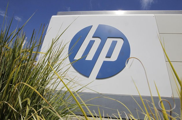 In this Aug. 21, 2012 photo, the Hewlett-Packard Co. logo is seen outside the company's headquarters in Palo Alto, Calif. Hewlett-Packard Co. reports quarterly financial results after the market close