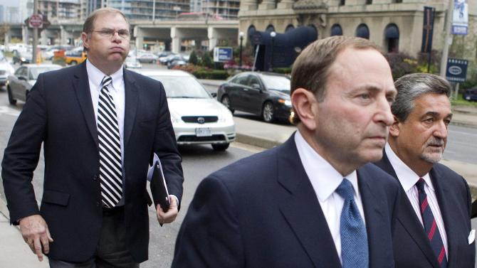 Craig Leipold, left, owner of Minnesota Wild, follows NHL Commissioner Gary Bettman, center, and Washington Capitals owner Ted Leonsis, right, leaves the NHLPA's following collective bargaining in Toronto on Thursday, Oct. 18, 2012. (AP Photo/The Canadian Press, Chris Young) offices with