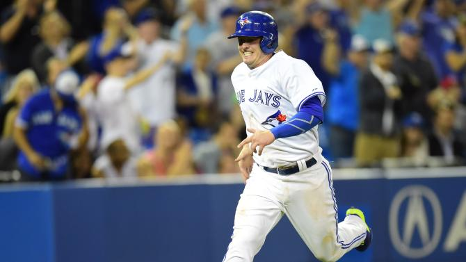 Toronto Blue Jays' Josh Donaldson runs in to score off a Jose Bautista double in seventh inning AL baseball action against the Chicago White Sox in Toronto on Tuesday, May 26, 2015.  (Frank Gunn/The Canadian Press via AP) MANDATORY CREDIT