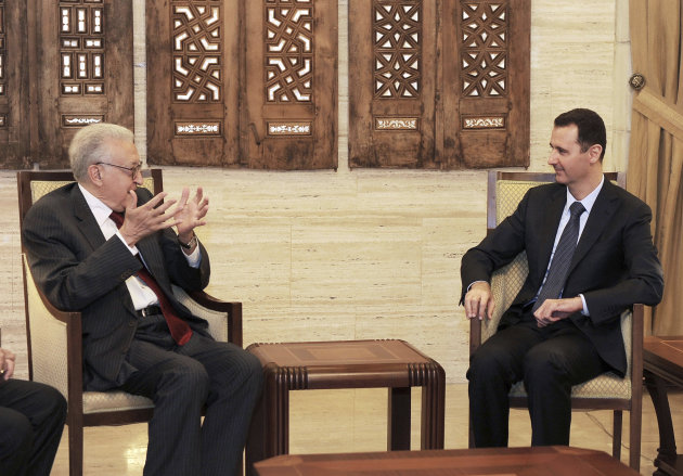 In this photo released by the Syrian official news agency SANA, Syrian President Bashar Assad, right, meets with the U.N.-Arab League envoy Lakhdar Brahimi, left, in Damascus, Syria, Saturday, Sept. 15, 2012. The new international envoy tasked with ending Syria's civil war says the country's conflict is a threat to world peace. (AP Photo/SANA)