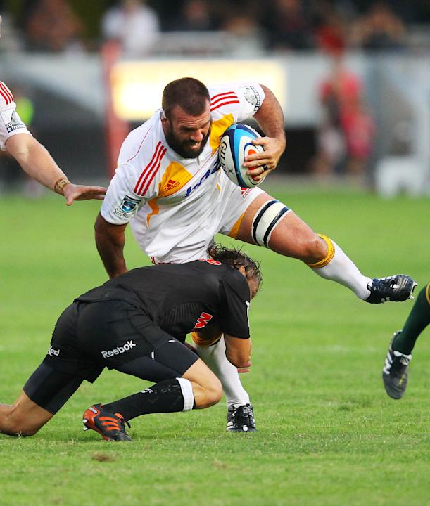 New Zealand Waikato Chiefs' Alex Bradley (Top) is tackled during the Super 15 rugby union match Sharks of Durban vs Waikato Chiefs of New Zealand at the Mr Price Kings Park Rugby Stadium on April 21,