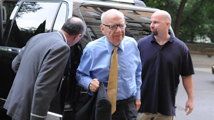 News Corporation head Rupert Murdoch arrives at his Fifth Avenue residence, Wednesday, July 20, 2011, in New York. Emerging relatively unscathed from a British parliamentary hearing on the phone hacking scandal, Rupert Murdoch returned to the United States on Wednesday, where his company faces a host of financial and legal challenges. (AP Photo/Louis Lanzano)