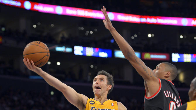 Los Angeles Lakers guard Steve Nash, left, puts up a shot as Portland Trail Blazers guard Damian Lillard defends during the first half of their NBA basketball game, Friday, Feb. 22, 2013, in Los Angeles. (AP Photo/Mark J. Terrill)