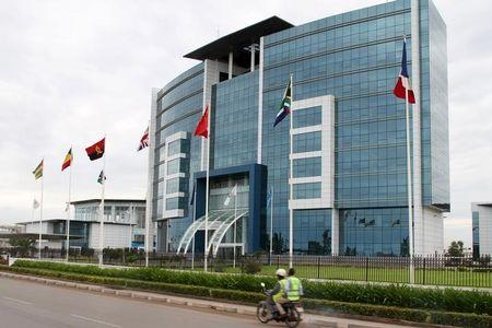 Motorcyclist rides past the Ecobank headquarters in Lome