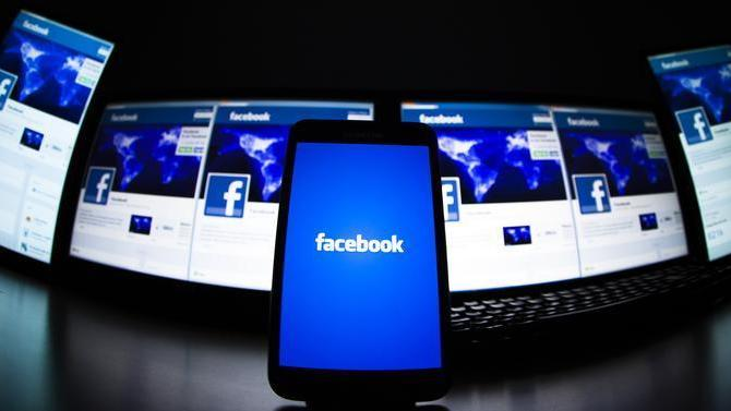 The loading screen of the Facebook application on a mobile phone is seen in this photo illustration taken in Lavigny