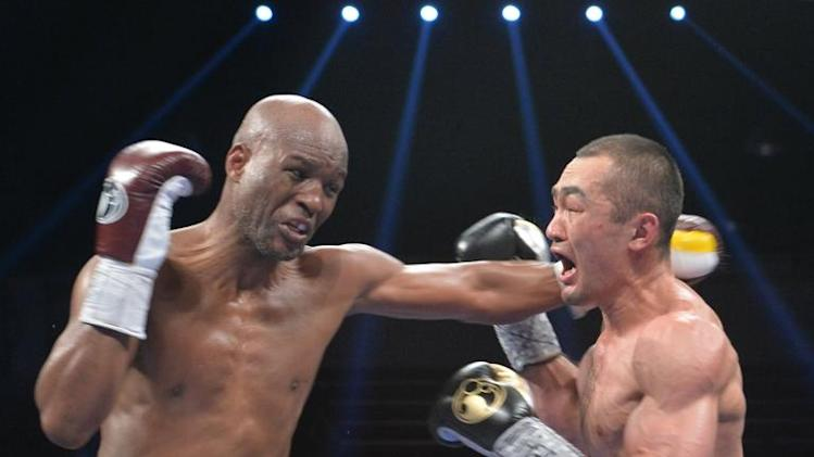 Bernard Hopkins (L) of the US defends against Beibut Shumenov (R) of the US during their WBA & IBA Light-heavyweight title fight at the DC Armory in Washington on April 19, 2014
