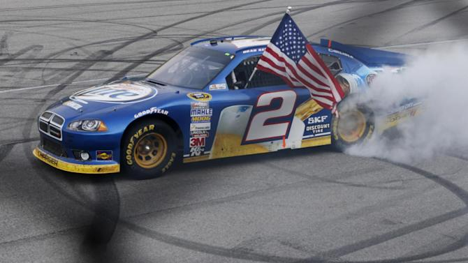 Brad Keselowski does a burnout after winning the NASCAR Sprint Cup Series auto race at Chicagoland Speedway in Joliet, Ill., Sunday, Sept. 16, 2012. (AP Photo/Tim Stewart)
