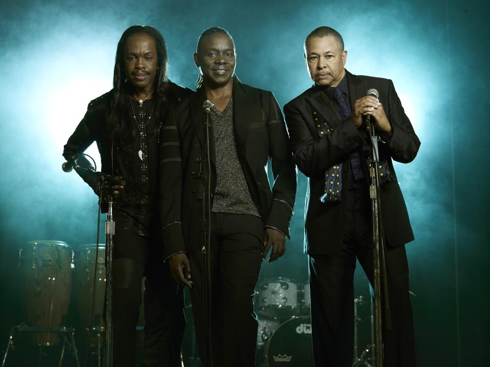 "This undated publicity image released by Sony Legacy shows, from left, Verdine White, Philip Bailey and Ralph Johnson from the band Earth, Wind & Fire. The group will release their first album in eight years called ""Now, Then & Forever"" on Sept. 10. (AP Photo/Sony Legacy)"