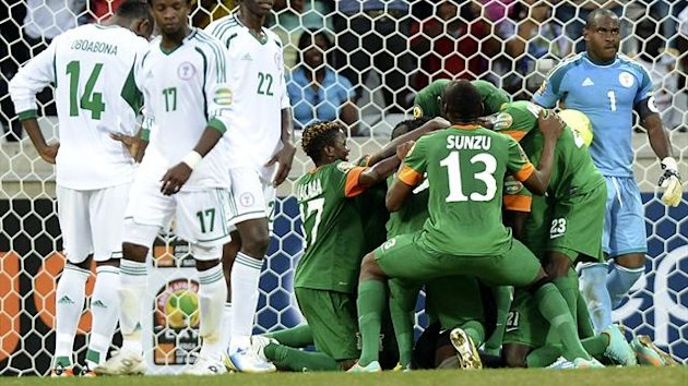 SOUTH AFRICA, Nelspruit : Zambia players celebrate at the team&#39;s goalkeeper scored a penalty on January 25, 2013 during an Africa Cup of Nations 2013 group A football match against Nigeria at the Mbombela stadium in Nelspruit. AFP PHOT...