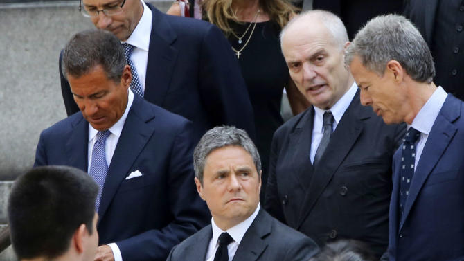 """HBO CEO Richard Plepler, left, Paramount CEO Brad Grey, center, and Soprano's creator David Chase, top second from right, leave the Cathedral Church of Saint John the Divine after the funeral service for James Gandolfini, Thursday, June 27, 2013 in New York. Gandolfini, who played Tony Soprano in the HBO show """"The Sopranos"""", died while vacationing in Italy last week. (AP Photo/Mary Altaffer)"""