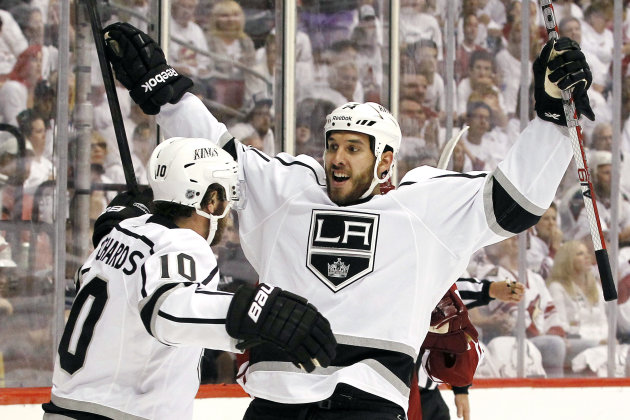 FILE - In this May 13, 2012, file photo, Los Angeles Kings&#39; Dwight King (74) celebrates his goal against the Phoenix Coyotes with Mike Richards (10) during the second period of Game 1 of the NHL hockey Stanley Cup Western Conference finals in Glendale, Ariz. King has five goals, including two game-winners in the Western Conference finals. He will look to continue that production as the Kings prepare for just their second Stanley Cup finals appearance in team history and are looking for their first title while waiting to take on the New Jersey Devils, Wednesday, May 30, in Newark, N.J. (AP Photo/Ross D. Franklin, File)