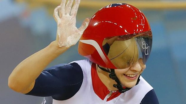 Britain's Joanna Rowsell celebrates after the track cycling women's team pursuit gold finals at the Velodrome during the London 2012 Olympic Games August 4, 2012 (Reuters)