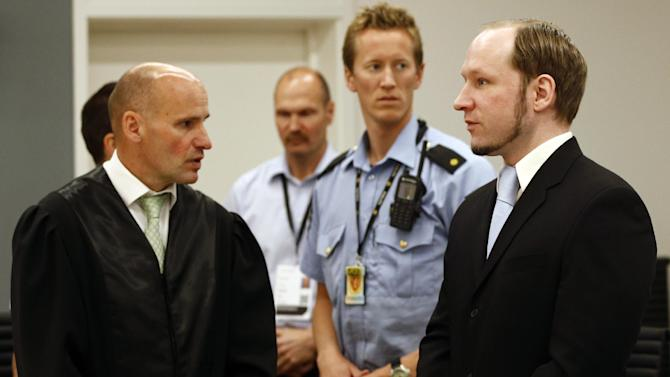 Terror charged Anders Behring Breivik, right, and his defense lawyer Geir Lippestad, left, in court in Oslo, Friday, June 22, 2012. On the last day of his trial, Anders Behring Breivik's defense lawyers on Friday tried to cast the confessed mass killer as political militant motivated by an extreme right-wing ideology rather than a delusional madman who killed 77 people for the sake of killing. (AP Photo/Lise Aserud/pool)