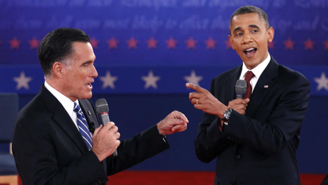 Republican presidential nominee Romney and U.S. President Obama answer a question at the same time during the second U.S. presidential campaign debate in Hempstead