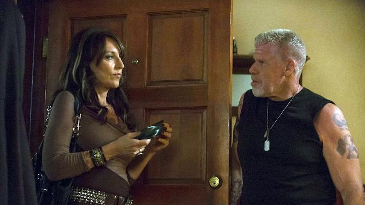 "This image released by FX shows Katey Sagal as Gemma Teller-Morrow, left, and Ron Perlman as Clay Morrow in a scene from ""Sons of Anarchy.""  The series airs Tuesdays at 10 p.m. EST on FX. (AP Photo/FX, Prashant Gupta)"