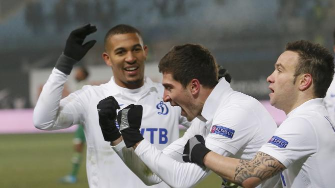 Dinamo Moscow's Aleksei Ionov (C) celebrates his goal with team mates William Vainqueur and Mathieu Valbuena during their Europa League soccer match against Panathinaikos at the Arena Khimki stadium outside Moscow