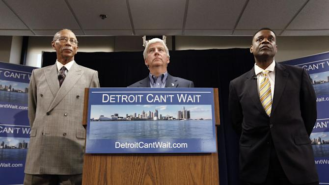 Detroit Mayor Dave Bing, left, Gov. Rick Snyder and Kevyn Orr, right, listen to a question during a news conference in Detroit, Thursday, March 14, 2013. Snyder announced that he had chosen Orr, a partner in the Cleveland-based law and restructuring Jones Day firm, as Detroit's emergency manager. Snyder's already declared a financial emergency in Detroit, saying local officials lacked a plan to solve it. (AP Photo/Paul Sancya)